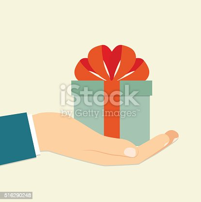 Isolated flat retro icon of a hand holding a blue gift box decorated with a red bow on white background. Vector illustration