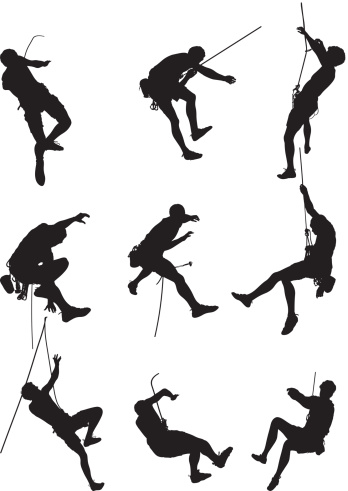 Isolated men rock climbing