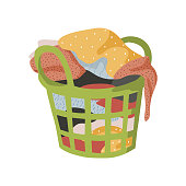 Isolated on white background basket with a bunch of dirty laundry. Vector hand-drawn flat illustration.