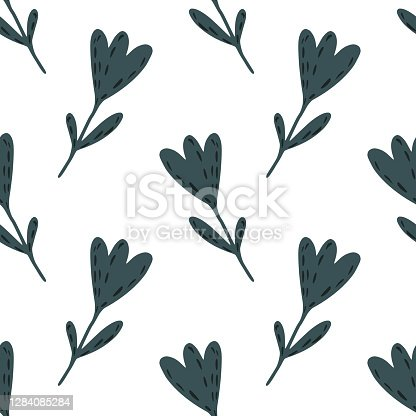 istock Isolated seamless doodle pattern with navy blue colore flower silhouettes. White background. 1284085284