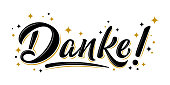 Isolated vector lettering with golden stars. Danke! - thank you in german