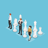 Flat 3d isometric business team standing with chess. Business strategy concept.