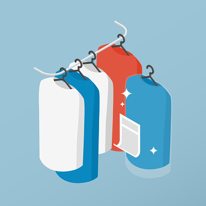Vector isometric clean clothes concept illustration. Clothes on the hangers after professional dry cleaning concept.