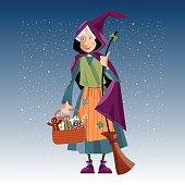 Italian Christmas tradition. Befana. Old woman with broom and basket.