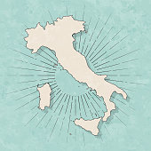 Map of Italy in a trendy vintage style. Beautiful retro illustration with old textured paper and light rays in the background (colors used: blue, green, beige and black for the outline). Vector Illustration (EPS10, well layered and grouped). Easy to edit, manipulate, resize or colorize.