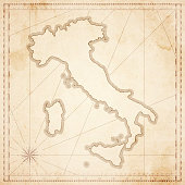 Map of Italy in vintage style. Beautiful illustration of antique map on an old textured paper of sepia color. Old realistic parchment with a compass rose, lines indicating the different directions (North, South, East, West) and a frame used as scale of measurement. Vector Illustration (EPS10, well layered and grouped). Easy to edit, manipulate, resize or colorize. Please do not hesitate to contact me if you have any questions, or need to customise the illustration. http://www.istockphoto.com/portfolio/bgblue