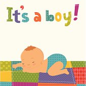 Baby boy sleepein on the patchwork blanket. Patchwork letters.