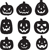 Vector silhouettes of a group of jack o lanterns.
