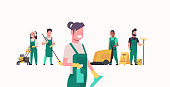 janitors team cleaning service concept male female cleaners in uniform working together with professional equipment flat full length horizontal vector illustration