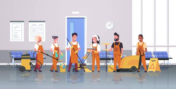 hausmeister team reinigungsservice konzept männliche frauenreiniger in gleichmäßiger arbeit mit professioneller ausstattung moderne korridor innenraum flach in voller länge horizontal - hausarbeit stock-grafiken, -clipart, -cartoons und -symbole