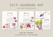 istock January, February, March calendar with ink calligraphy elements and dessert and tea illustration. 1090563314