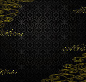 黒毛は黄金の粉と川を背景。