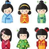 Japanese Kokeshi Dolls icons. Kawaii asian girls wearing kimono isolated on the white background. Flat vector illustration