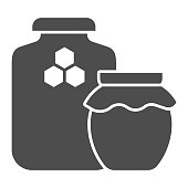 istock Jars of honey solid icon, beekeeping concept, natural honey in pots sign on white background, Two honey jar with honeycomb icon in glyph style for mobile and web. Vector graphics. 1253761861