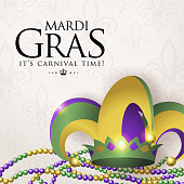 Celebrate Mardi Gras with colorful jester hat and beans on the carnival