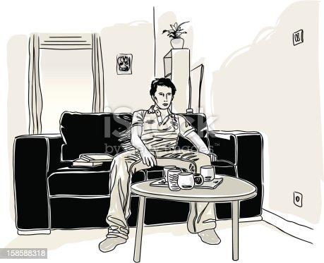 istock Jeune homme seul dans son salon. 158588318