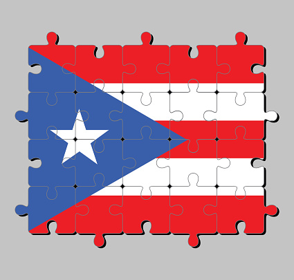 Jigsaw puzzle of Puerto Rico flag in horizontal white and red bands with isosceles triangle based on the hoist side and star.