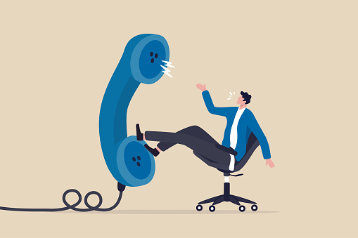 Job interview via phone call or conference meeting on telephone concept, smart confidence businessman job candidate answer interview questions with big telephone from recruiter or employer.