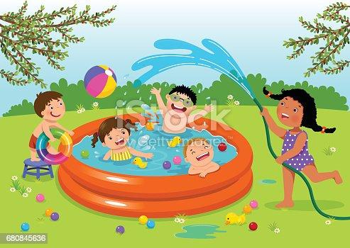 Joyful kids playing in inflatable pool in the backyard