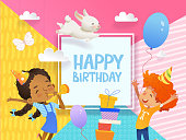 Joyous Boy and girl in birthday hats happily jump. Vector Illustration of a Happy Birthday Greeting Card with balloons, cute rabbits, a bunch of presents on the background