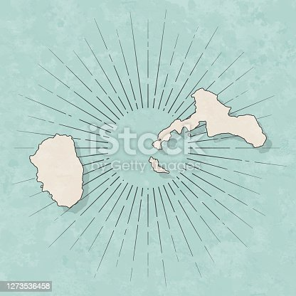 Map of Juan Fernandez Islands in a trendy vintage style. Beautiful retro illustration with old textured paper and light rays in the background (colors used: blue, green, beige and black for the outline). Vector Illustration (EPS10, well layered and grouped). Easy to edit, manipulate, resize or colorize.