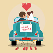 just married couple in love car