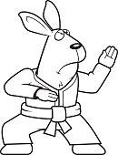 A cartoon rabbit doing karate in a gi.
