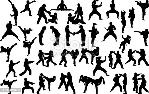 A large set of silhouettes of children of girls practicing karate in different stances during the strike and blocks