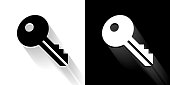 Key Black and White Icon with Long Shadow. This 100% royalty free vector illustration is featuring the square button and the main icon is depicted in black and in white with a black icon on it. It also has a long shadow to give the icons more depth.