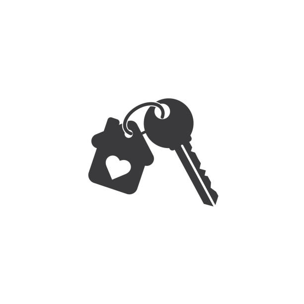 Keychain with key ring and a pendant house with heart locket. Keychain with key ring house key stock illustrations