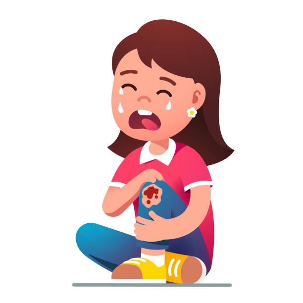stockillustraties, clipart, cartoons en iconen met kid meisje zittend huilen in pijn over pijn knie - alleen één meisje