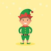 Kid in a Christmas Elf costume