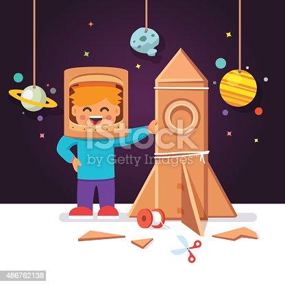 istock Kid making cardboard box rocket, astronaut costume 486762138