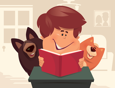 kid reading with dog and cat