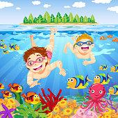 Kids have fun underwater in summer.