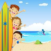 Three children hiding behind surfboard.