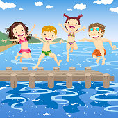 Four children jumping into lake at wooden pier.