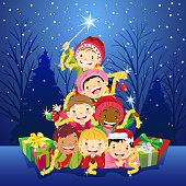Multi-ethnic Group of children pile up as a Christmas tree