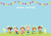 Illustration of cute kids playing egg hunt at grassland.