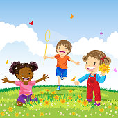 Three kids outdoor playing in spring.