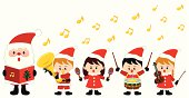 a group of cute kids playing instrument in Christmas time.