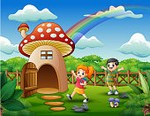 Kids playing on the fantasy house of mushroom