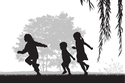 A vector silhouette illustration of three young children running outside on the grass.