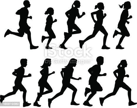 A group of kids running in silhouette.