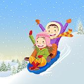 Two kids sledding in winter.