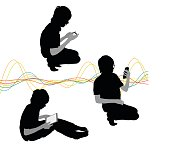 A vector silhouette illustration of a young boy using electonic devices in various poses including sitting and using a tablet on his lap, crouched and using a smart phone, and kneeling taking a selfie.  A multicoloured wave pattern is the background.