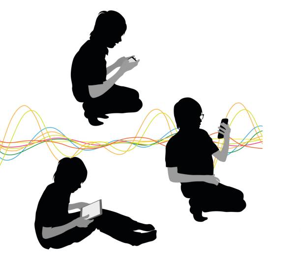 Kids Tech A vector silhouette illustration of a young boy using electonic devices in various poses including sitting and using a tablet on his lap, crouched and using a smart phone, and kneeling taking a selfie.  A multicoloured wave pattern is the background. digital native stock illustrations