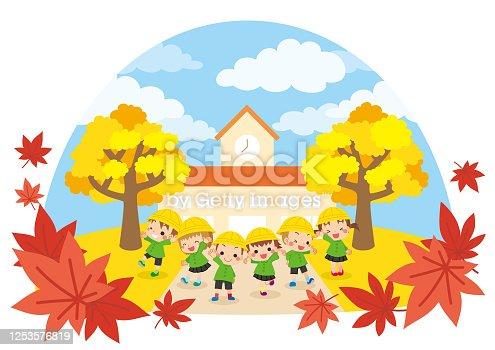 istock Kindergarten kids in Autumn 1253576819