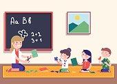 Kindergarten teacher teaching math to her pupils
