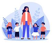istock Kindergarten teacher walking with kids 1217089640
